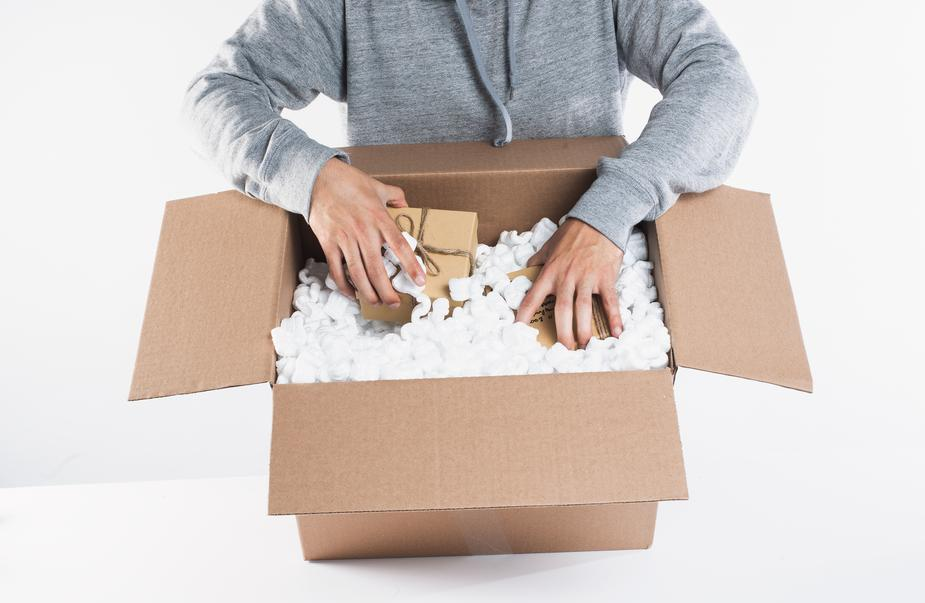 some-packages-being-placed-into-packing-materials